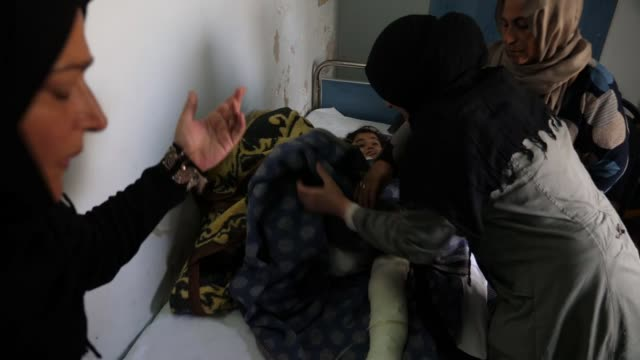 hundreds with suspected links to islamic state escape from prison camp syria qamishli int sara lying in hospital bed and nariman adel holding her... - prison escape stock videos and b-roll footage