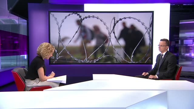 hungarian foreign minister peter szijjarto interview; england: london: gir: int peter szijjarto interview sot - re refugee and migrant crisis,... - traditionally hungarian stock videos & royalty-free footage