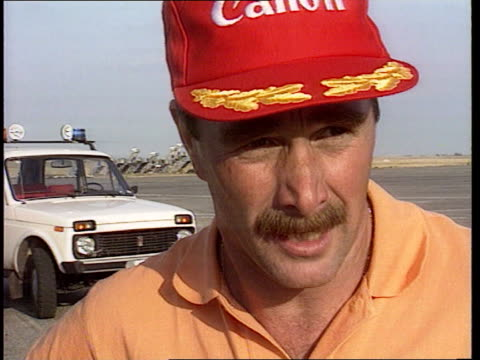 Hungarian Grand Prix Mansell wins championship CMS Intvw Nigel Mansell SOF Thanks team sponsors fans MS Mansell along to plane as shakes crew as past...