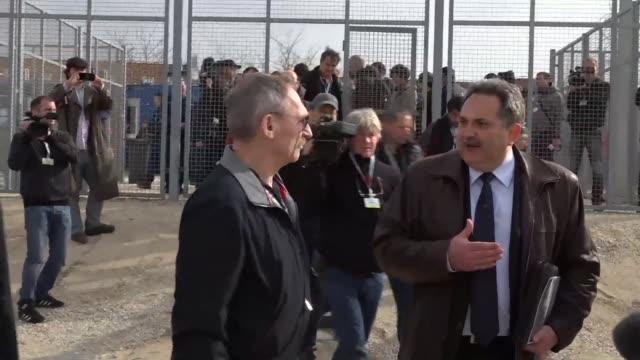 vídeos de stock e filmes b-roll de hungarian interior minister sandor pinter visits a transit zone a closed area for migrants in tompa at the border with serbia - cultura da europa de leste