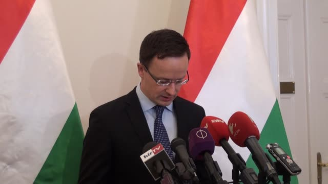 hungarian minister of foreign affairs and trade peter szijjarto delivers a speech during a press conference regarding the immigrant reconciliation... - eastern european culture stock videos and b-roll footage