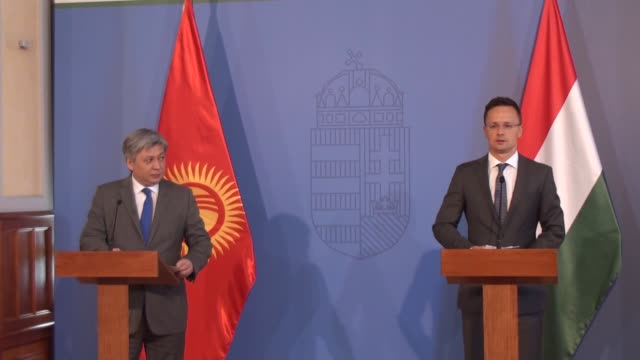 hungarian minister of foreign affairs and trade peter szijjarto and kyrgyzstan's foreign minister erlan abdyldaev hold a joint press conference after... - osteuropäische kultur stock-videos und b-roll-filmmaterial