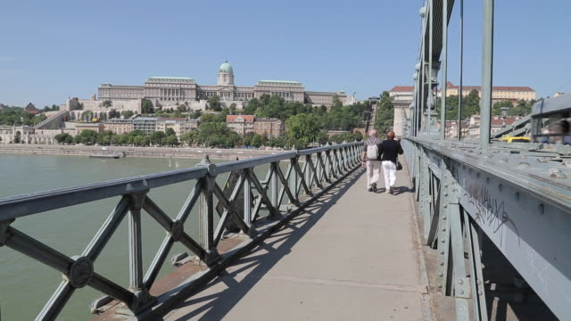 hungarian nation gallery from chain bridge szechenyi lamchid,& river danube, budapest, hungary, europe - chain bridge suspension bridge stock videos & royalty-free footage