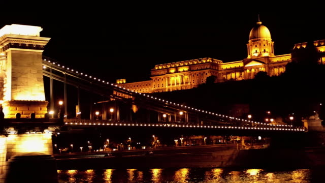 stockvideo's en b-roll-footage met 05 hungarian parliament building and danube river - traditionally hungarian