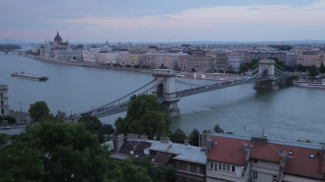 hungarian parliament, chain bridge szechenyi lamchid, & river danube from castle hill district, budapest, hungary, europe - chain bridge suspension bridge stock videos & royalty-free footage
