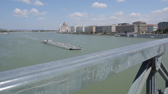 hungarian parliament & river danube from chain bridge szechenyi lamchid, (orszaghaz), budapest, hungary, europe - chain bridge suspension bridge stock videos & royalty-free footage