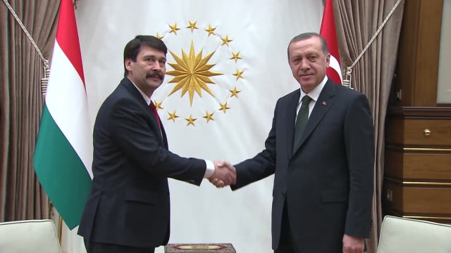 hungarian president janos ader is welcomed by turkish president recep tayyip erdogan with an official welcoming ceremony at the presidential palace... - eastern european culture stock videos & royalty-free footage