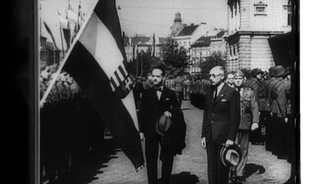 hungarian prime minister laszlo bardossy de bardos inspects troops during world war ii - osteuropäische kultur stock-videos und b-roll-filmmaterial