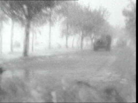 hungarian refugees flee into austria hungary shot along road past soviet tanks and convoy as snowing gvs soviet tanks austrian border gv field gv... - traditionally hungarian stock videos & royalty-free footage