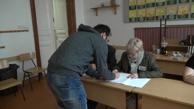 hungarian voters cast their ballots in budapest as european elections take place throughout europe for the 21 member states who have not yet voted - cast member stock videos and b-roll footage