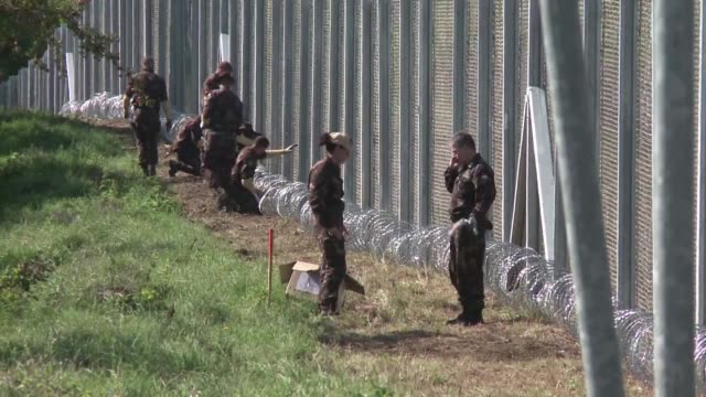 stockvideo's en b-roll-footage met hungary's parliament approves the automatic detention of all asylumseekers in container camps at the borders sparking deep concern at the un refugee... - hongarije