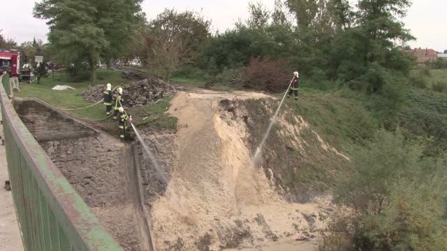 hungary's toxic sludge spill, which has killed four people, reached the danube river thursday, threatening to contaminate the waterway's ecosystem, a... - 50 seconds or greater stock videos & royalty-free footage