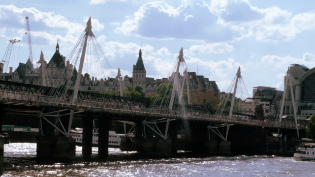 hungerford bridge and golden jubilee bridges of london on the thames - hungerford bridge stock videos & royalty-free footage