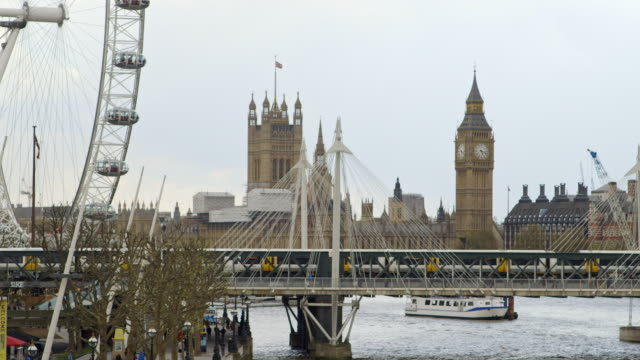 ms hungerford bridge and waterloo bridge with houses of parliament in background / london, england, united kingdom - hungerford bridge stock videos & royalty-free footage