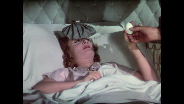 1937 Hungover woman (Carole Lombard) sucks egg administered by doctor (Charles Winninger)