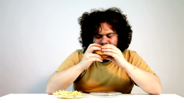 hungry man eating fast food - mouth open stock videos and b-roll footage