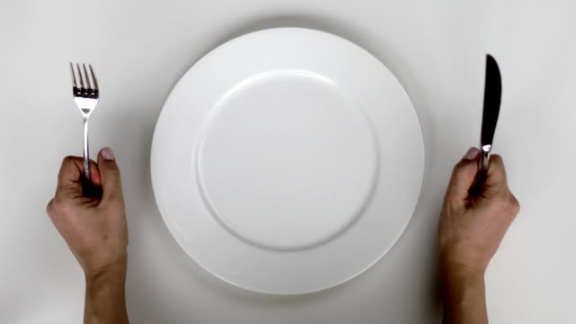 hungry woman waiting to be served - table top view stock videos & royalty-free footage