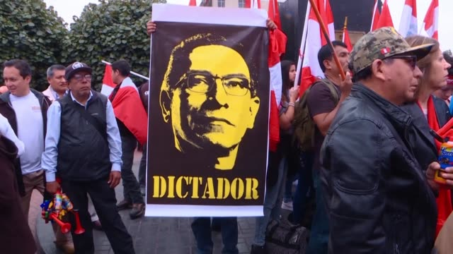 hunreds of peruvians protest in lima against president martin vizcarra and his decision to dissolve congress - martín vizcarra stock videos & royalty-free footage