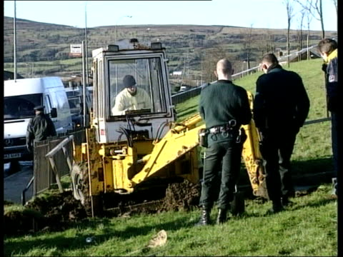 hunt for ira victims; margaret mckinney and others sat in room belfast: ext mechanical digger being used to excavate ground in search for bodies of... - bog stock videos & royalty-free footage
