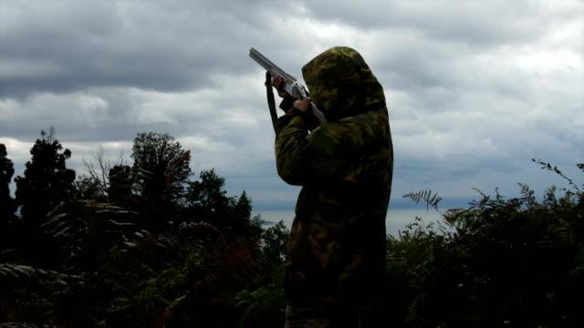 Hunter aiming gun towards sky, shooting birds/ Batumi city, Georgia, Caucasus