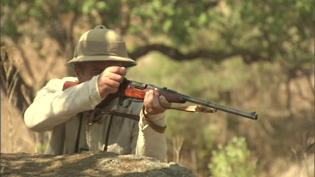 a hunter aims and fires a bolt-action rifle. - 動物を使うスポーツ点の映像素材/bロール
