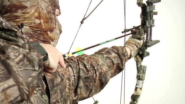 hunter drawing bow back - bow and arrow stock videos and b-roll footage