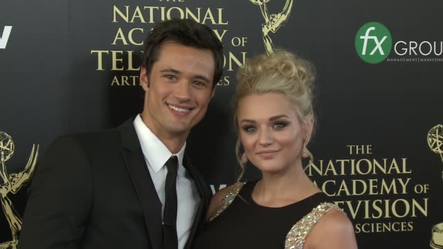 hunter king and matthew atkinson at the 2014 daytime emmy awards at the beverly hilton hotel on june 22, 2014 in beverly hills, california. - the beverly hilton hotel点の映像素材/bロール