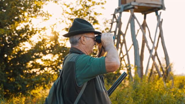 ms hunter looking through binoculars - rifle stock videos & royalty-free footage
