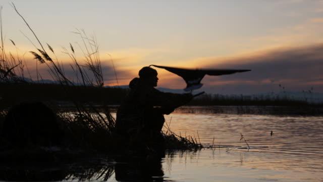 hunter using duck decoy - springville utah stock videos & royalty-free footage