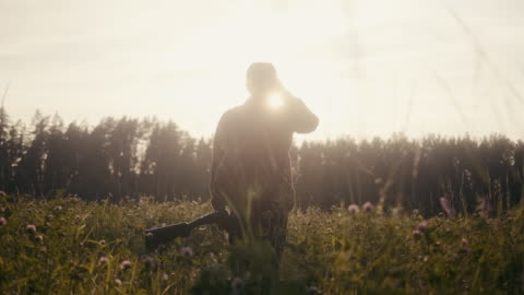 hunter with binoculars in the sunset (slow motion) - survival stock videos & royalty-free footage