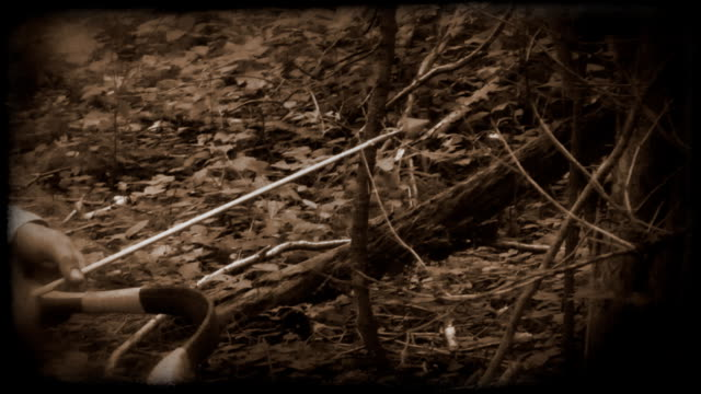 hunter with bow - archery bow stock videos and b-roll footage