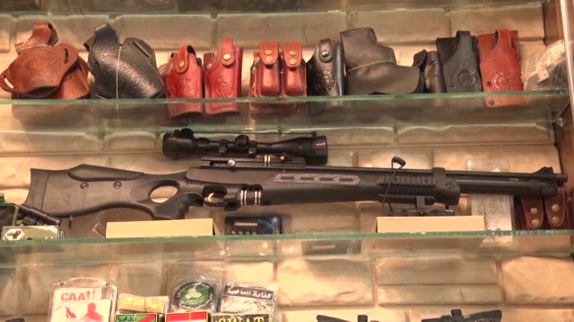 hunting rifles pistols and towers of ammunition magazines gun shops are popping up in iraq's mosul where residents are keen to own personal firearms... - ammunition stock videos and b-roll footage