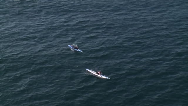 ktla – huntington beach ca us aerial view of veterans paddling from catalina island to huntington beach in honor of veterans day holiday on monday... - channel islands california stock videos & royalty-free footage