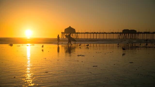 - huntington beach pier sunset timelapse - huntington beach california stock videos and b-roll footage