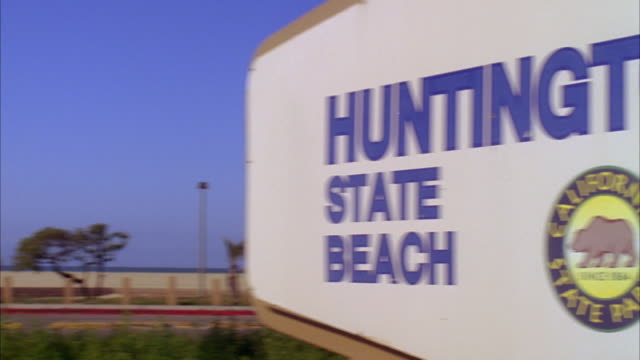 ws cu pan huntington state beach sign on roadside / huntington beach, california, usa - huntington beach california stock videos and b-roll footage
