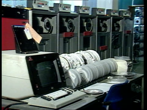 hurricaine report hurricaine report itn bracknell met office side computer showing exposed wiring pull out ms array of computers woman walks lr... - science and technology stock videos and b-roll footage