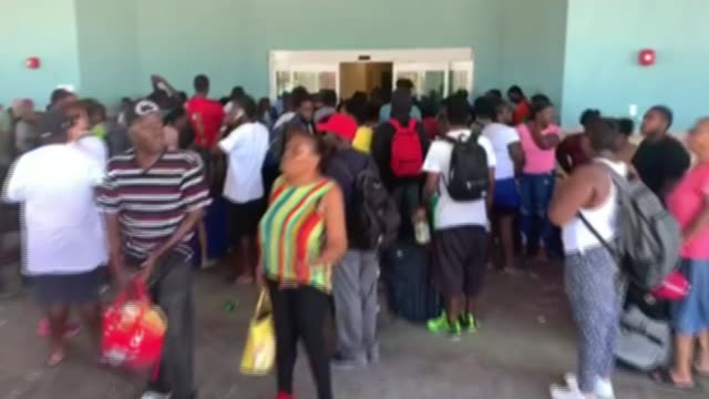 desperate need for food and water for survivors the bahamas great abaco island ext crowd of people outside airport crowd of people - survival stock videos & royalty-free footage