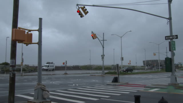 hurricane force wind gusts cause traffic signals to sway side to side at the intersection of beach 94th street and shore front parkway during... - scott mcpartland stock videos & royalty-free footage