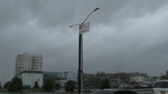 hurricane force wind gusts rattle parking signs and street lights as tropical storm isaias bears down on rockaway beach queens new york new york - scott mcpartland stock videos & royalty-free footage
