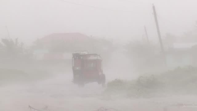 hurricane force winds and torrential rain lash motorbike taxi. super typhoon megi or juan, ne luzon, philippines oct 2010 / audio - luzon stock videos & royalty-free footage