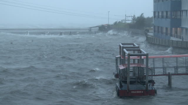 Hurricane force winds blow across Legaspi harbor as powerful typhoon Ramassun makes landfall on 15th July 2014