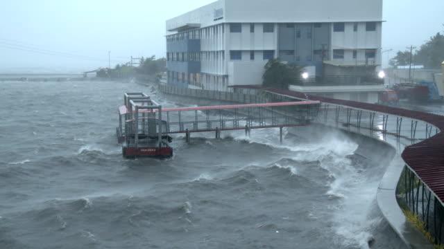 vídeos de stock, filmes e b-roll de hurricane force winds blow across legaspi harbor as powerful typhoon ramassun makes landfall on 15th july 2014 - quebra mar