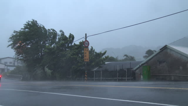 hurricane force winds lash a small town in southern taiwan as typhoon matmo makes landfall in july 2014 - pacific ocean stock videos & royalty-free footage