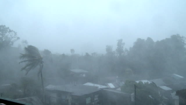Hurricane force winds rip through Legaspi city as powerful typhoon Ramassun makes landfall on 15th July 2014