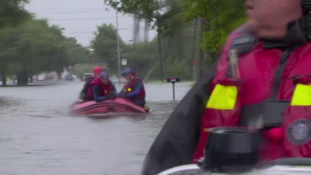 Hurricane Harvey now a Tropical Storm returns to land in Louisiana after devastating Texas EXT Reporter to camera SOT Rescue workers along flooded...