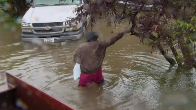 hurricane harvey now a tropical storm returns to land in louisiana after devastating texas usa texas houston ext flooded street man wading through... - rescue worker stock videos & royalty-free footage