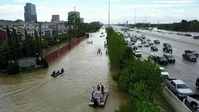 Hurricane Harvey now a Tropical Storm returns to land in Louisiana after devastating Texas USA Texas EXT **Local Radio Station overlaid SOT** Various...