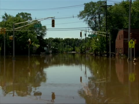 stockvideo's en b-roll-footage met hurricane irene aftermath manville new jersey in this shot there is a city street under water hurricane irene of 2011 was an atlantic hurricane that... - new jersey