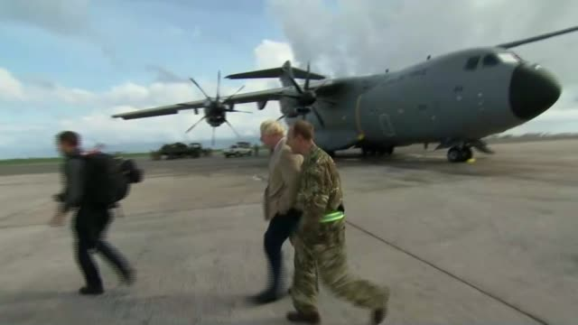 Boris Johnson arrives in Barbados Johnson at airfield BARBADOS EXT Various of aid supplies being unloaded from RAF transport aircraft / various of...