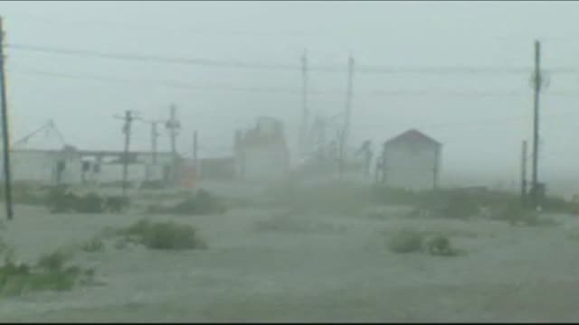 wgno hurricane isaac has rain fill the streets on august 29 2012 in grand isle louisiana - levee stock videos & royalty-free footage